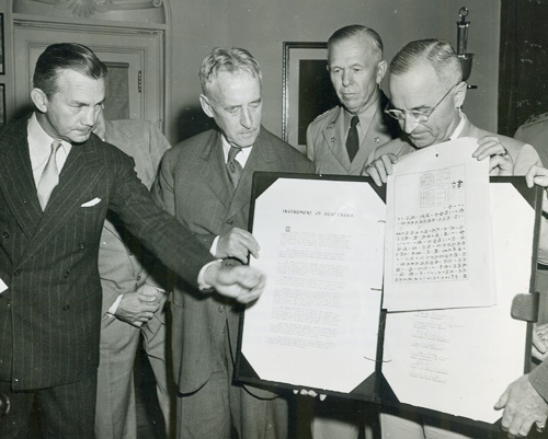 President Truman with Japanese surrender documents